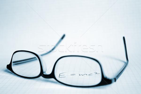 Glasses and paper with Albert Einstein's E=mc2  Stock photo © inoj