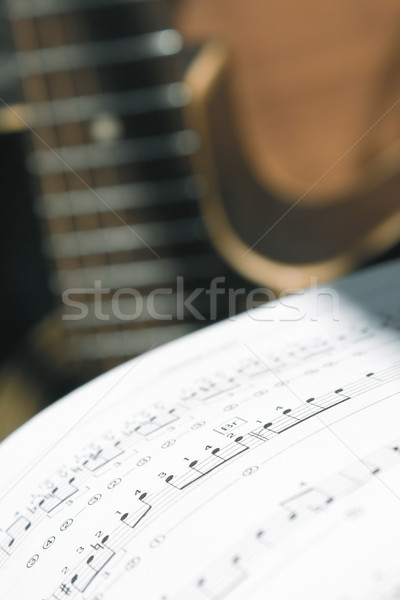 Musical background. Music notes and guitar  Stock photo © inoj