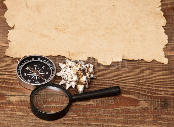 old paper, compass and magnifying glass on wood background Stock photo © inxti