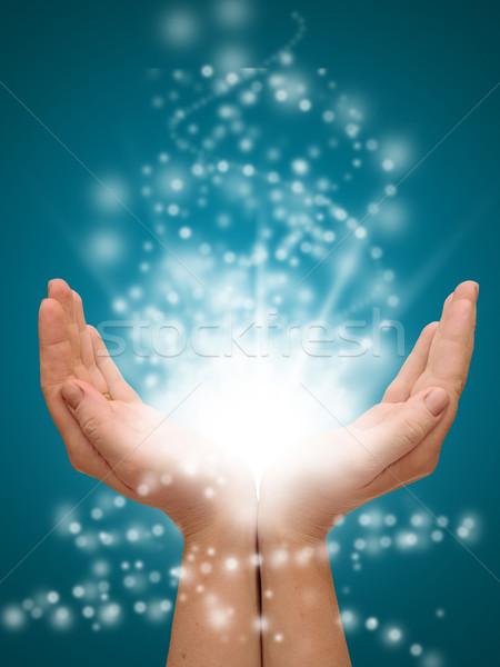 Kéz a kézben nyitva izzó fények kéz fény Stock fotó © inxti