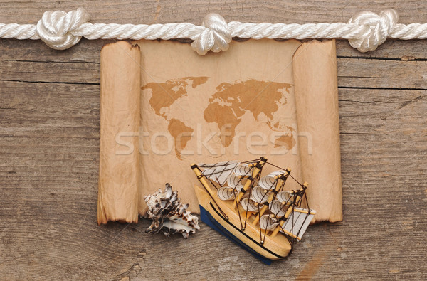 old crumpled world map on wooden background Stock photo © inxti