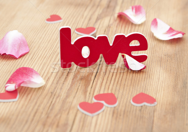 Love word and rose petal on a rustic background   Stock photo © inxti