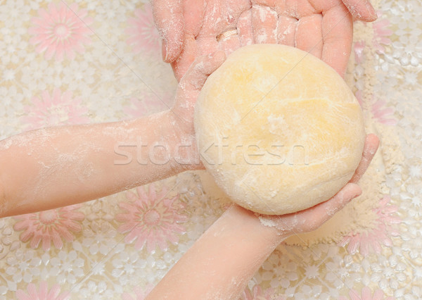 A child is helping mom to knead the dough for baking  Stock photo © inxti
