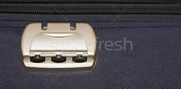closeup photo of a combination lock on a black suitcase  Stock photo © inxti