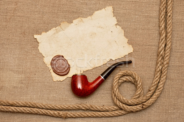 pipe and rope with old paper  Stock photo © inxti
