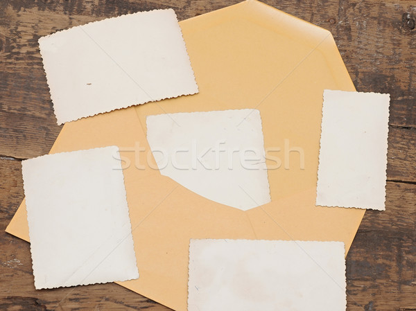 vintage background with old photo and yellow envelope on old woo Stock photo © inxti