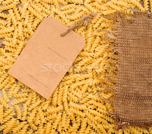 pasta and price tag on sack burlap as background  Stock photo © inxti