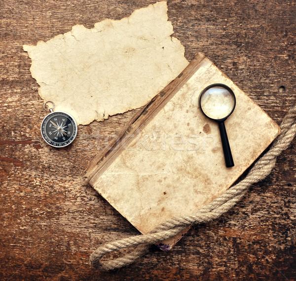 Eski kitap pusula ahşap kâğıt kitap Stok fotoğraf © inxti