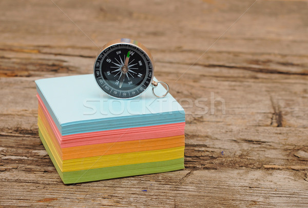 colorful post it note block with compass on wood table Stock photo © inxti