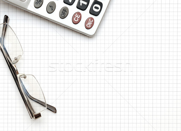 eyeglass, and calculator on the working paper Stock photo © inxti