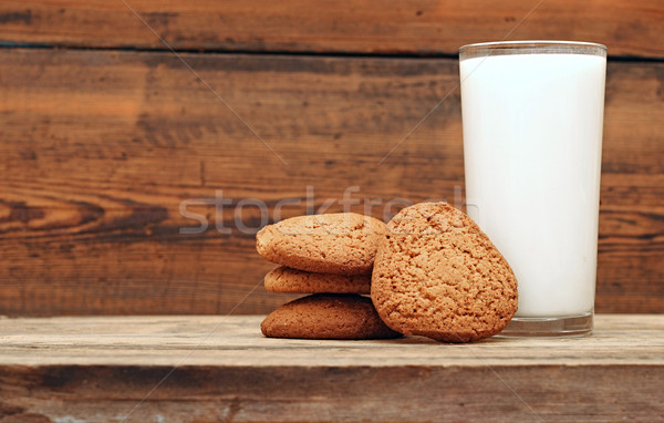 glass of milk and oat cookies on wooden background, close-up  Stock photo © inxti