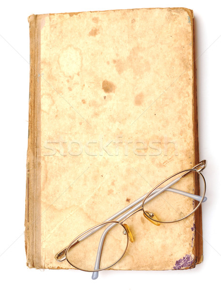 old book with eyeglass  Stock photo © inxti