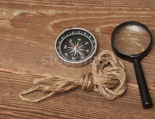 rope, compass and magnifying glass on wood background Stock photo © inxti