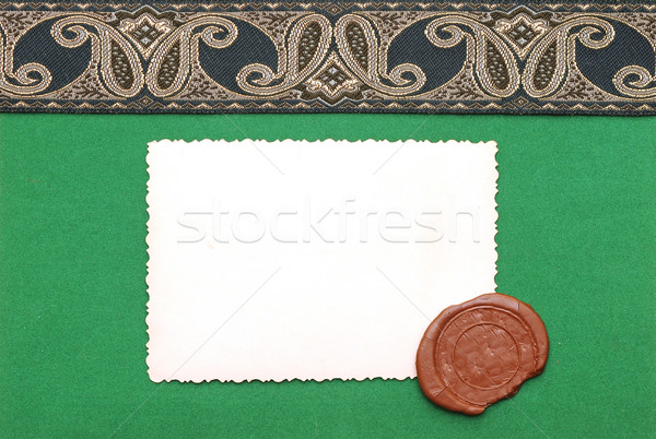 old photo with antique ribbon on green paper Stock photo © inxti