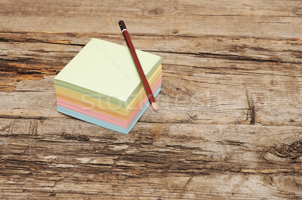 Pencil and the block of stickers on wooden background Stock photo © inxti