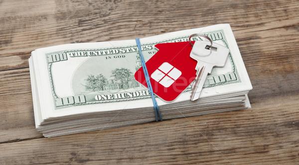 Ház kulcsok száz dollár bankjegyek fából készült Stock fotó © inxti