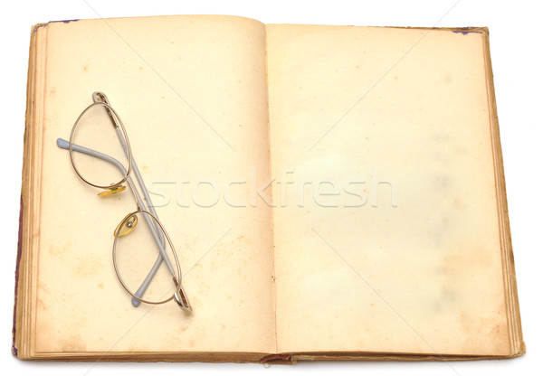 opened old book with eyeglass Stock photo © inxti
