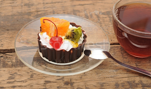 delicious cake with fruit and a cup of tea Stock photo © inxti