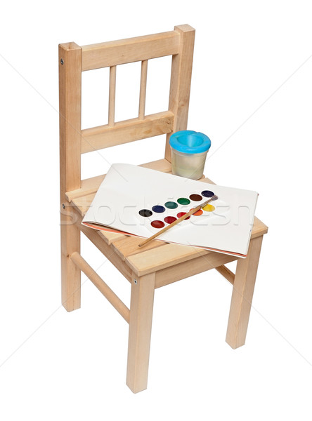 a little wooden chair with paints and brushes to paint isolated  Stock photo © inxti