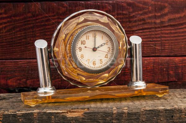Vintage background with retro alarm clock on table Stock photo © inxti