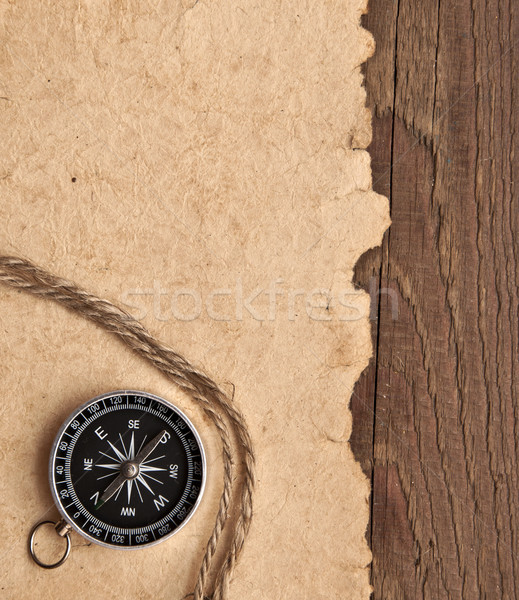 Stock photo: compass and rope on wood background