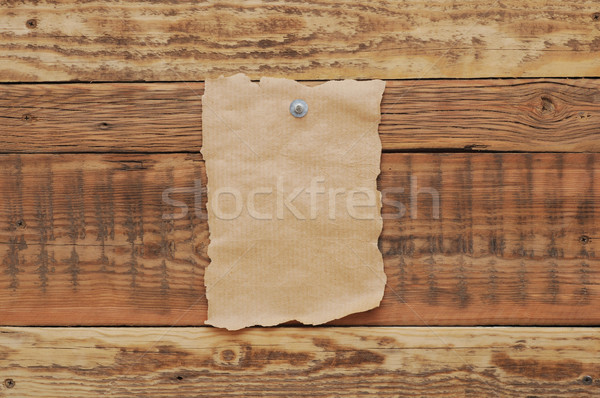 Old paper tacked to a wood wall  Stock photo © inxti
