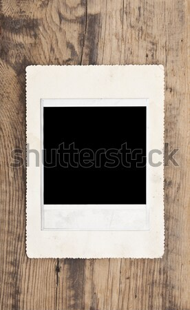 old photos on wooden wall Stock photo © inxti