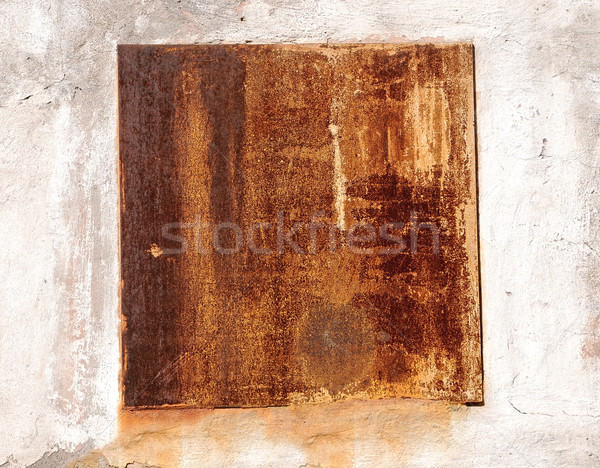 A cracked rusty metal wall. Background for design  Stock photo © inxti