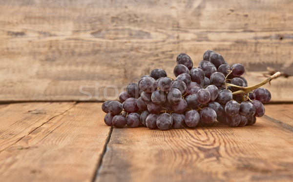 Bunch black grapes on old wooden table Stock photo © inxti