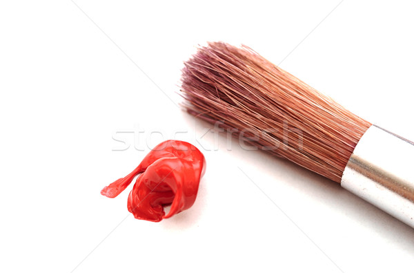 Paintbrush and red color on white Stock photo © inxti
