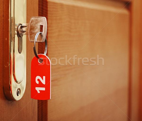 Porta madeira asa chave da porta buraco de fechadura número Foto stock © inxti