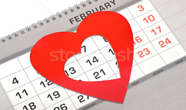 Red heart shape marker on calendar page showing February 14 Vale Stock photo © inxti
