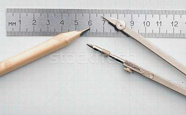 Geometry set with compass,pencil,ruler on graph paper Stock photo © inxti