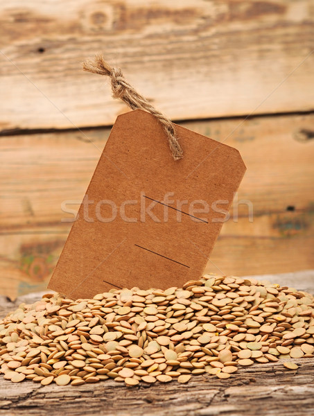 Lentil seeds with blank price tag on a wooden background Stock photo © inxti