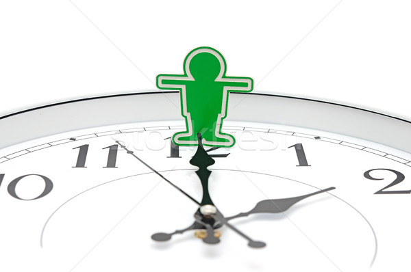 Businessman trying to stop time  Stock photo © inxti