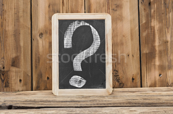 a chalkboard with a question marks written on it  Stock photo © inxti