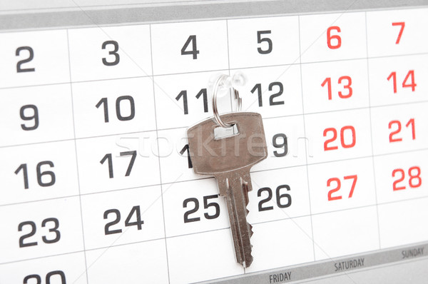 A house key on a calendar background, paying your mortgage on ti Stock photo © inxti