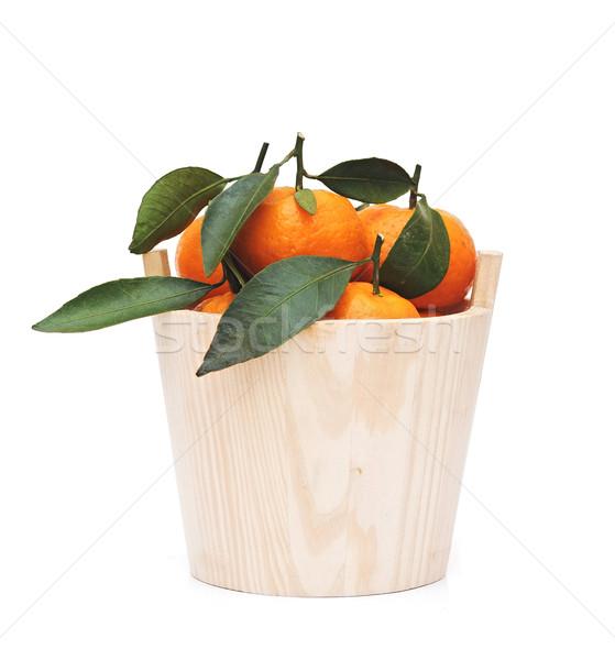 Sweet fresh mandarin in the wood bowl  Stock photo © inxti