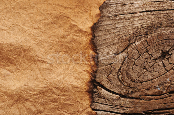 Old paper on brown wood board Stock photo © inxti