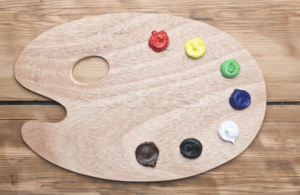 wooden artists palette loaded with various colour paints on old  Stock photo © inxti