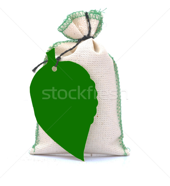 hessian bag with green blank tag in form leaf isolated on white Stock photo © inxti