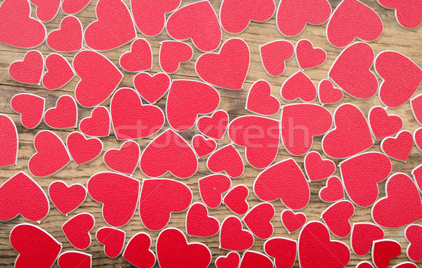 Tiny red hearts on wooden background Stock photo © inxti