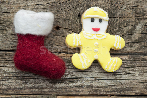 Santa or christmas boot on a wooden background for a greeting ca Stock photo © inxti