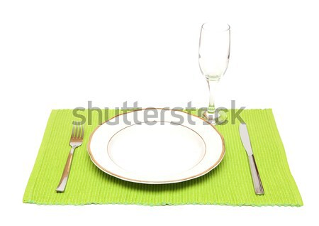 Empty dish with old paper, knife and fork and green napkin on wo Stock photo © inxti
