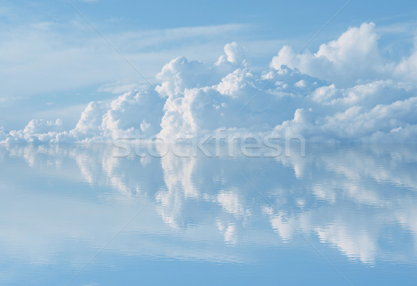 Stock photo: blue sky reflecting on water,