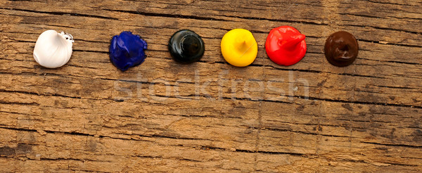 colorful paint over old wood table Stock photo © inxti