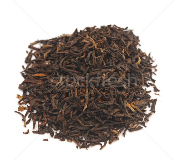 Handful of black tea leaves on white background Stock photo © inxti