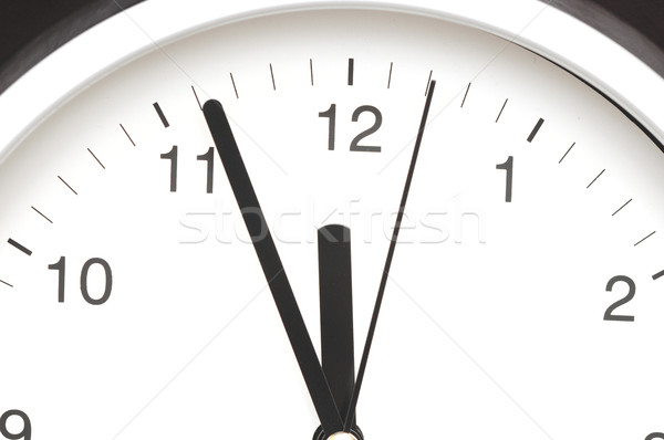 Photo of clock showing five minutes to noon  Stock photo © inxti