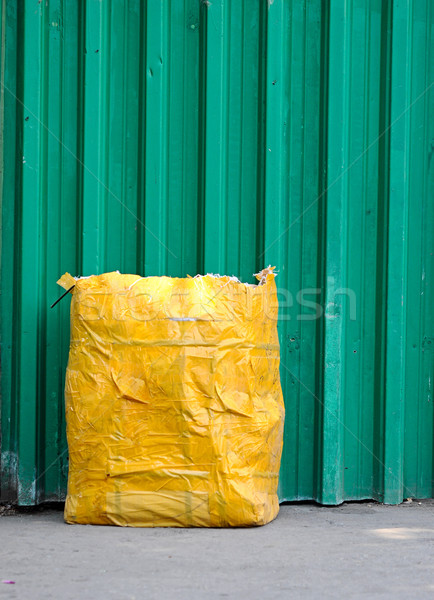 yellow garbage bag  front green fence Stock photo © inxti