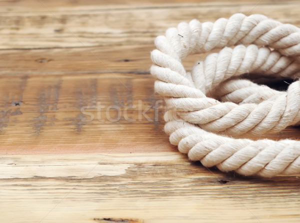 rope on weathered wood background with copy space Stock photo © inxti